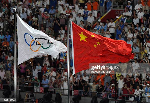 The Olympic Flag is raised in the National Stadium during the opening ceremony on Friday August 8 to kick off the Games of the XXIX Olympiad in...