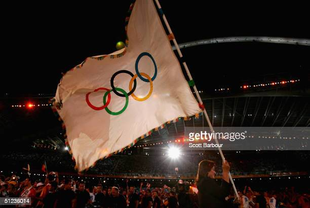 The Olympic flag is seen during the closing ceremonies of the Athens 2004 Summer Olympic Games on August 29, 2004 at the Sports Complex Olympic...