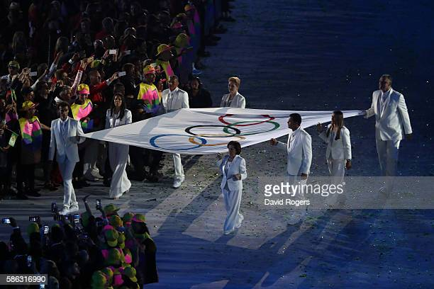 The Olympic flag is seen during the Opening Ceremony of the Rio 2016 Olympic Games at Maracana Stadium on August 5 2016 in Rio de Janeiro Brazil
