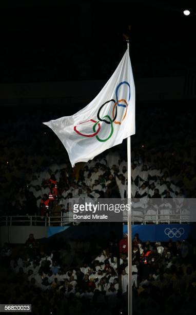 The Olympic flag is seen during the Opening Ceremony of the Turin 2006 Winter Olympic Games on February 10, 2006 at the Olympic Stadium in Turin,...
