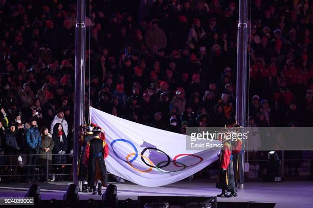 The Olympic flag is taken down and folded during the Closing Ceremony of the PyeongChang 2018 Winter Olympic Games at PyeongChang Olympic Stadium on...