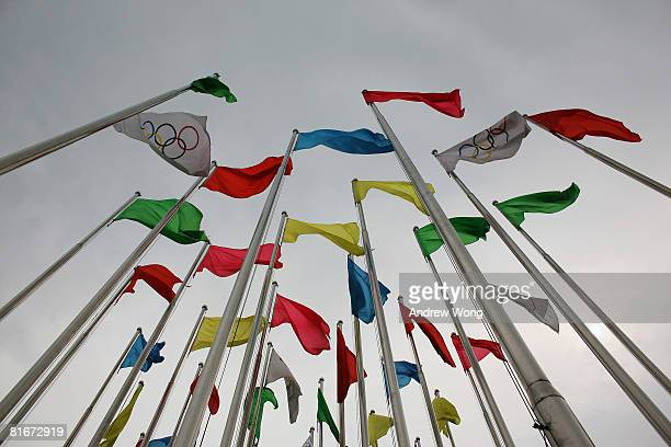 The Olympic flags fly outside an Olympic exhibition on June 23 2008 in Shenyang Liaoning province China Shenyang is one of the four Olympic soccer...