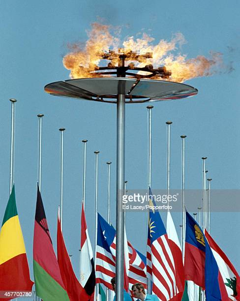 The Olympic flame and participating nation's flags at halfmast commemorating the Munich Massacre during the Summer Olympic Games in Munich circa...