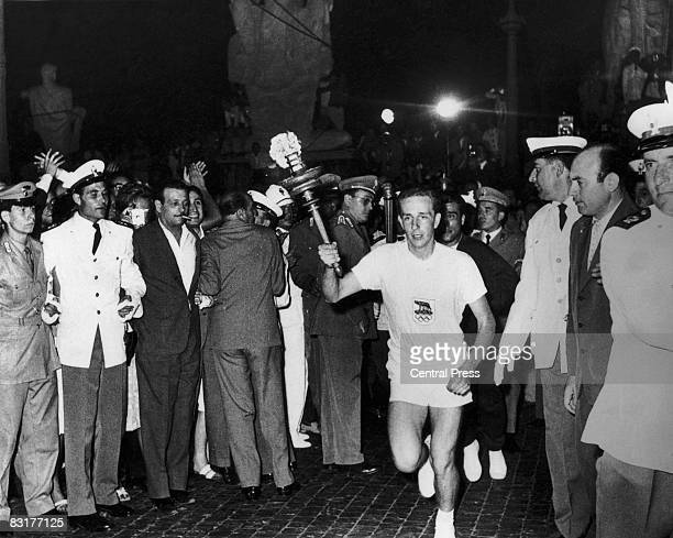 The Olympic flame arrives in Rome for the opening ceremony of the Rome Olympics 25th August 1960