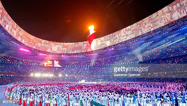 The Olympic flame burns a top the stadium during the Opening Ceremony for the 2008 Beijing Summer Olympics at the National Stadium on August 8 2008...
