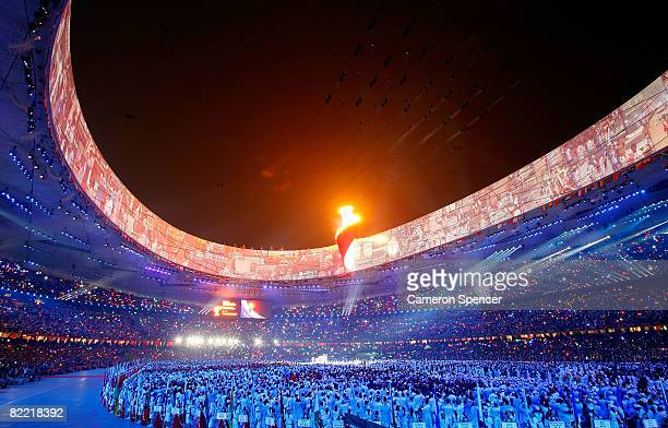 The Olympic flame burns a top the stadium during the Opening Ceremony for the 2008 Beijing Summer Olympics at the National Stadium on August 8, 2008...