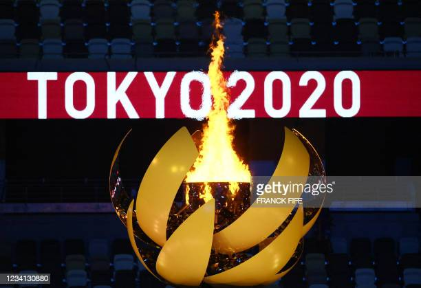 The Olympic Flame burns after the lighting of the Olympic Cauldron during the opening ceremony of the Tokyo 2020 Olympic Games, at the Olympic...