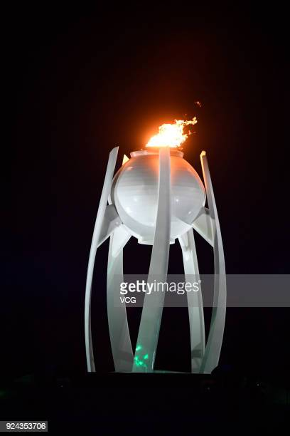 The Olympic flame burns during the Beijing segment during the Closing Ceremony of the PyeongChang 2018 Winter Olympic Games at PyeongChang Olympic...