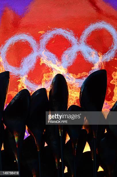 The Olympic flame burns in front of the Olympic logo during the London 2012 Olympic Games athletics event held at the Olympic Stadium in London on...