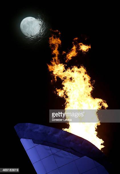 The Olympic flame burns in front on the moon on day six of the Sochi 2014 Winter Olympics on February 13, 2014 in Sochi, Russia.