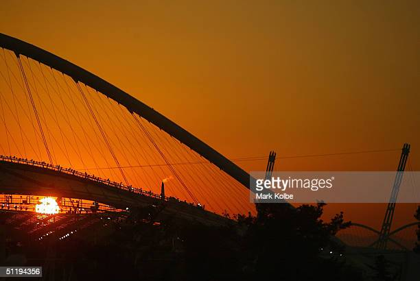 The Olympic flame burns over the Olympic Stadium as the sun sets on August 19, 2004 during the Athens 2004 Summer Olympic Games in Athens, Greece.