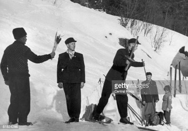 The Olympic Flame is brought out from the hearth of the old cottage of Sondre Norheim in Morgedal Telemark from whence it will be carried by a relay...