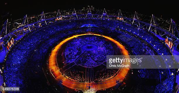 The Olympic Flame is carried into the Olympic Stadium during the Opening Ceremony of the London 2012 Olympic Games on July 27 2012 in London England