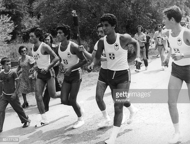 The Olympic Flame is carried to Athens from the Temple of Hera in Olympia 16th July 1976 From there it will be transported to Canada for the opening...