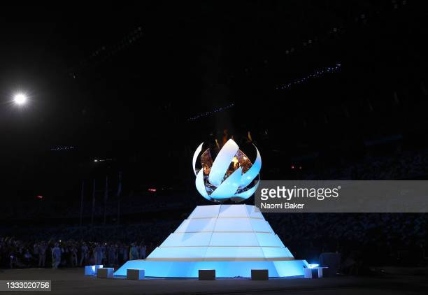 The olympic flame is extinguished during the Closing Ceremony of the Tokyo 2020 Olympic Games at Olympic Stadium on August 08, 2021 in Tokyo, Japan.