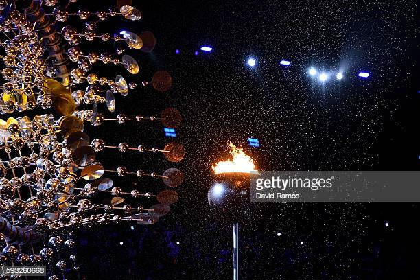 The Olympic flame is extinguished during the Closing Ceremony on Day 16 of the Rio 2016 Olympic Games at Maracana Stadium on August 21 2016 in Rio de...