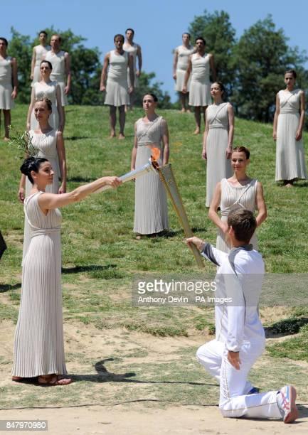 The Olympic Flame is lit by an actress dressed as the High Priestess during a rehearsal for tomorrow's ceremony which signals to the world that the...