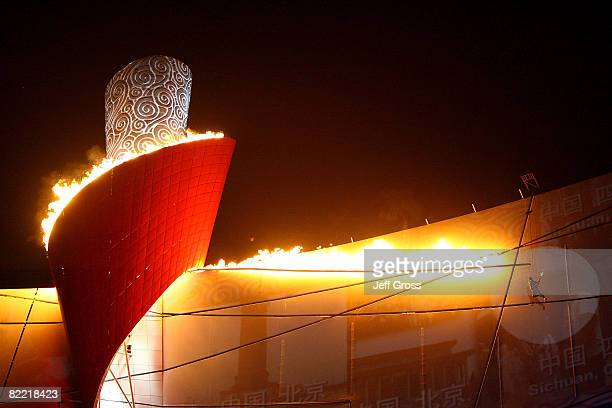 The Olympic Flame is lit by former gymnast Li Ning during the Opening Ceremony for the 2008 Beijing Summer Olympics at the National Stadium on August...