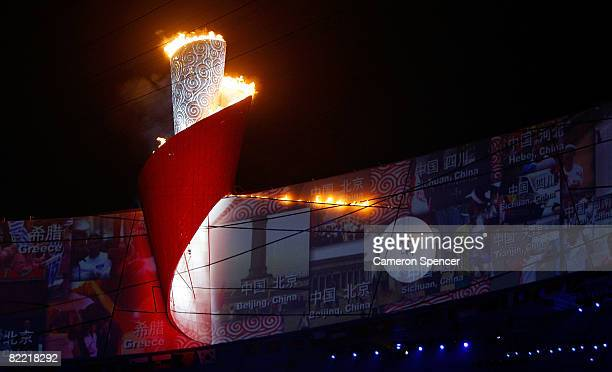 The Olympic flame is lit by Li Ning former Olympic gymnast for China during the Opening Ceremony for the 2008 Beijing Summer Olympics at the National...