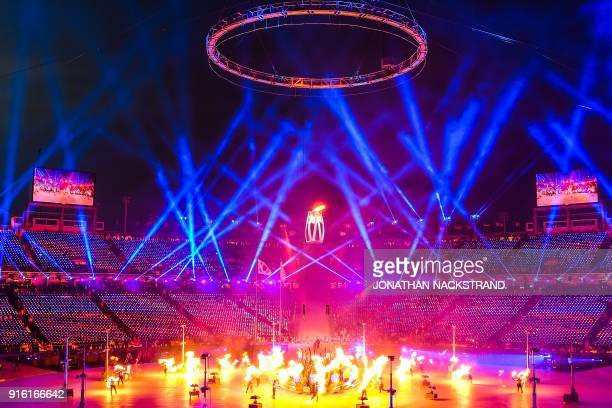The Olympic Flame is lit during the opening ceremony of the Pyeongchang 2018 Winter Olympic Games at the Pyeongchang Stadium on February 9 2018 / AFP...