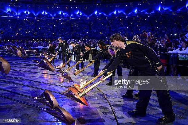 The Olympic flame is lit inside the stadium during the opening ceremony of the London 2012 Olympic Games on July 27 2012 at the Olympic stadium in...