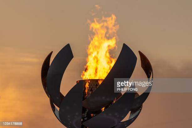 The Olympic flame is seen burning on the cauldron at Ariake Yume-no-Ohashi Bridge in Tokyo on July 25, 2021 during the Tokyo 2020 Olympic Games.