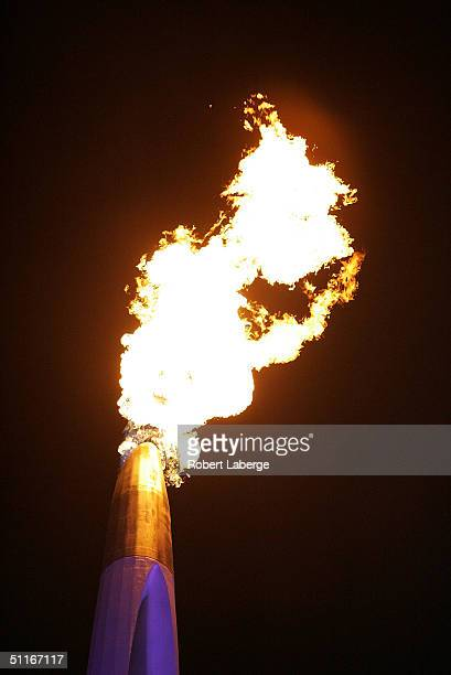 The Olympic flame is seen during the opening ceremony of the Athens 2004 Summer Olympic Games on August 13, 2004 at the Sports Complex Olympic...