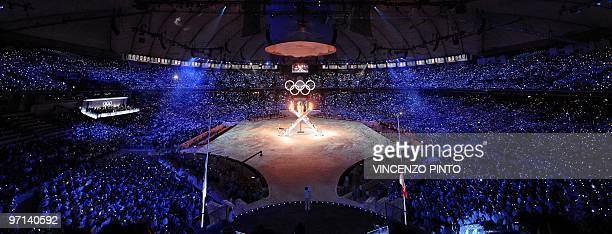 The Olympic flame lights up the stadium during the opening ceremony of the Vancouver 2010 Winter Olympics at BC place venue on February 12 2010 in...