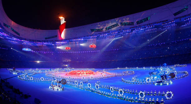"""The Olympic flame shines brightly for the last evening during closing ceremonies in the National Stadium also known as """"The Birds Nest"""" as the 2008..."""