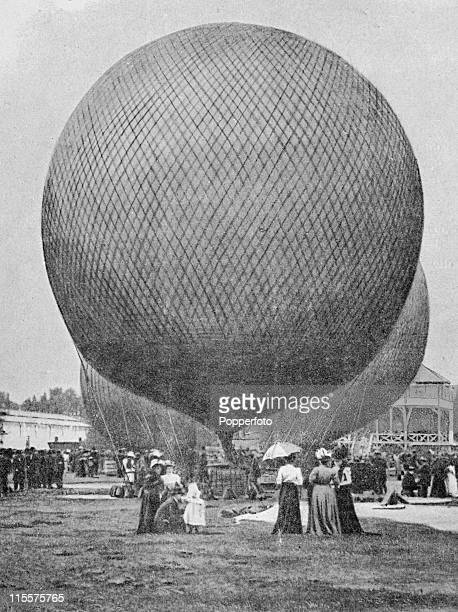 The Olympic Games were held during the Great Exposition in Paris, 1900. This images shows spectators looking at the hotair balloons in the park at...