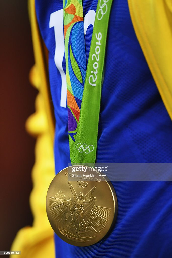 The Olympic gold medal hangs arounf the neck of Neymar of Brazil after the Olympic Men's Final Football match between Brazil and Germany at Maracana Stadium on August 20, 2016 in Rio de Janeiro, Brazil.