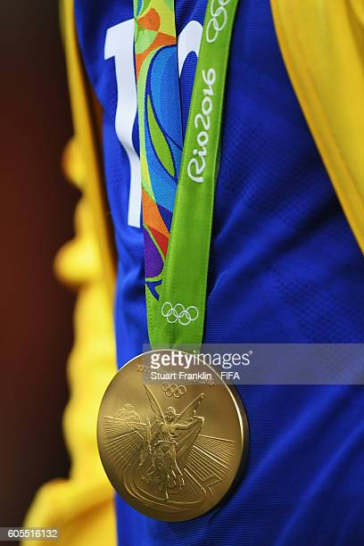 The Olympic gold medal hangs arounf the neck of Neymar of Brazil after the Olympic Men's Final Football match between Brazil and Germany at Maracana...