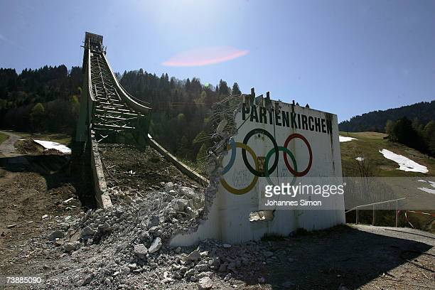 The Olympic hoops are seen at the base of the Garmisch Partenkirchen ski jump after it was demolished by explosives on April 14, 2007 in...