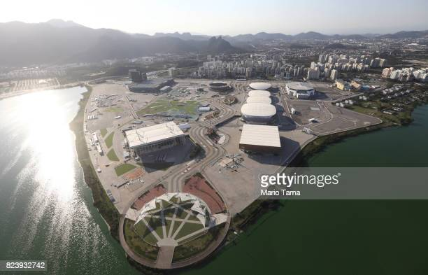 The Olympic Park stands along a polluted waterway, tinted green by algae, in the Barra da Tijuca neighborhood on July 27, 2017 in Rio de Janeiro,...