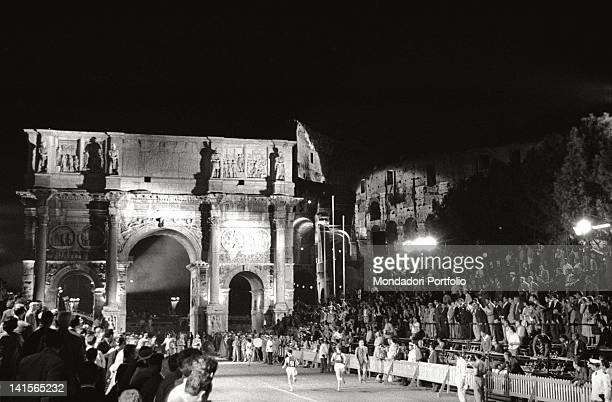The Olympic public waiting the arrival of the marathon race participants near the Arch of Constantine Rome 1960