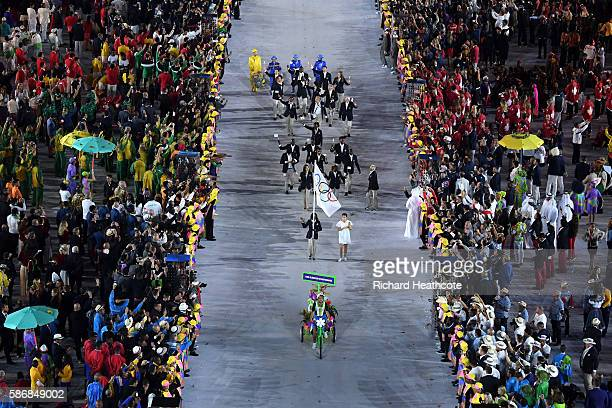 The Olympic Refugee team enter the atheletes parade during the Opening Ceremony of the Rio 2016 Olympic Games at Maracana Stadium on August 5 2016 in...