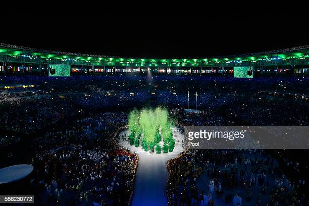 The Olympic Rings are formed in green during the Opening Ceremony of the Rio 2016 Olympic Games at Maracana Stadium on August 5 2016 in Rio de...