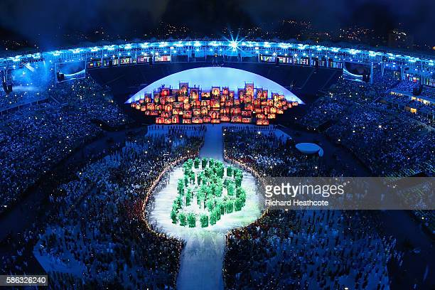 The Olympic Rings are formed in green foliage during the Opening Ceremony of the Rio 2016 Olympic Games at Maracana Stadium on August 5 2016 in Rio...