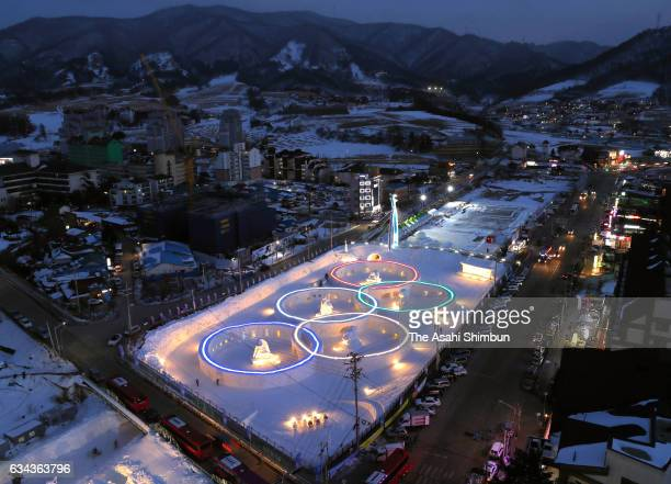 The Olympic Rings are illuminated at a snow festival site on the day of the PyeongChang 2018 one year to go on February 9 2017 in Pyeongchang South...