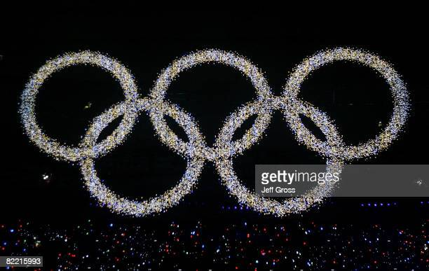 The Olympic rings are illuminated during the Opening Ceremony for the 2008 Beijing Summer Olympics at the National Stadium on August 8, 2008 in...
