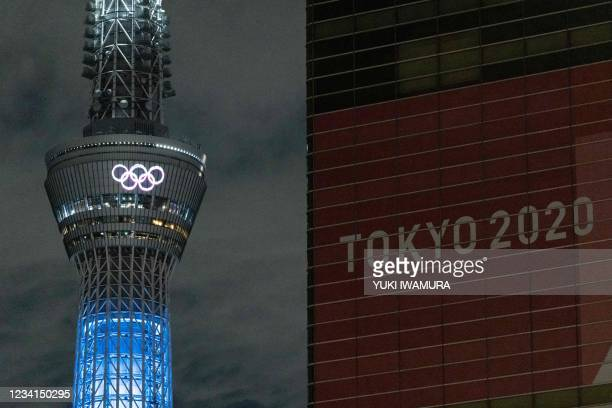 The Olympic rings are illuminated on Tokyo Skytree in Tokyo on July 24, 2021.