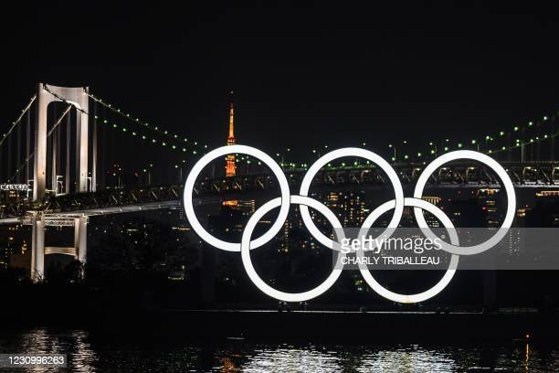 The Olympic Rings are lit up at the Odaiba waterfront in Tokyo on February 6, 2021.