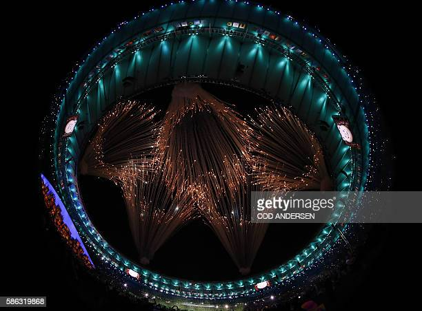 The Olympic Rings are made by fireworks during the opening ceremony of the Rio 2016 Olympic Games at the Maracana stadium in Rio de Janeiro on August...