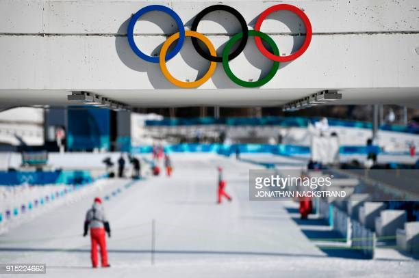 TOPSHOT The Olympic Rings are pictured at the biathlon shooting range ahead of the Pyeongchang 2018 Winter Olympic Games in Pyeongchang on February 7...