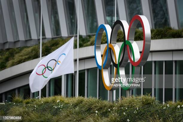 The Olympic Rings are pictured in front of the headquarters of the International Olympic Committee in Lausanne on March 22 as doubts increase over...
