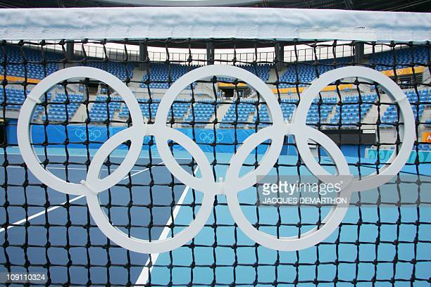 The Olympic rings are pictured on the net of the central court at the tennis complex in Athens 09 August 2004 four days before the start of the 2004...