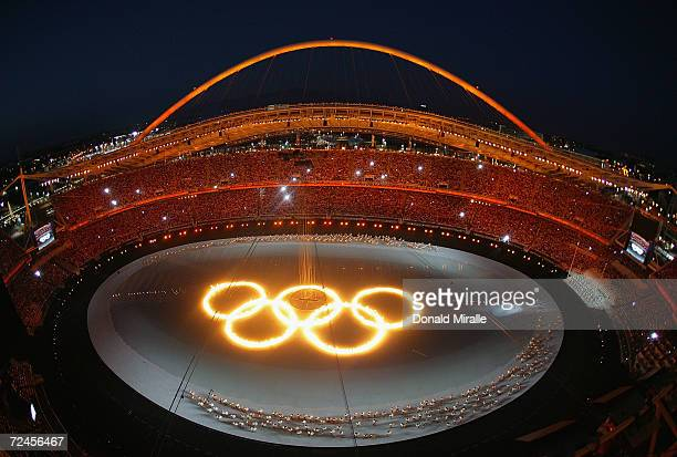 The Olympic rings are seen as drummers perform during the opening ceremony of the Athens 2004 Summer Olympic Games on August 13, 2004 at the Sports...
