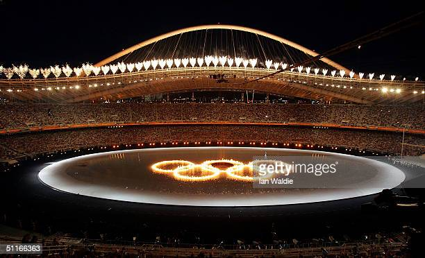 The Olympic rings are seen as fireworks are ignited during the opening ceremony of the Athens 2004 Summer Olympic Games on August 13 2004 at the...