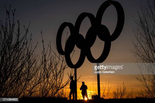 The Olympic rings are seen as sunset in the Olympic Park in Stratford as Tokyo Olympics organisers are considering options to delay the Olympics with...