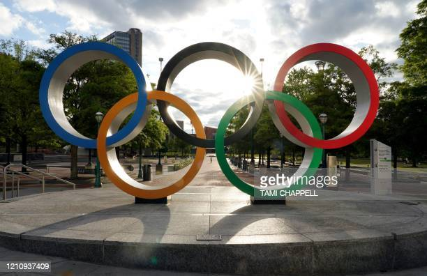 The Olympic rings are seen at the entrance to a mostly deserted Centennial Park in Atlanta Georgia on April 24 2020 Governor Brian Kemp has eased...